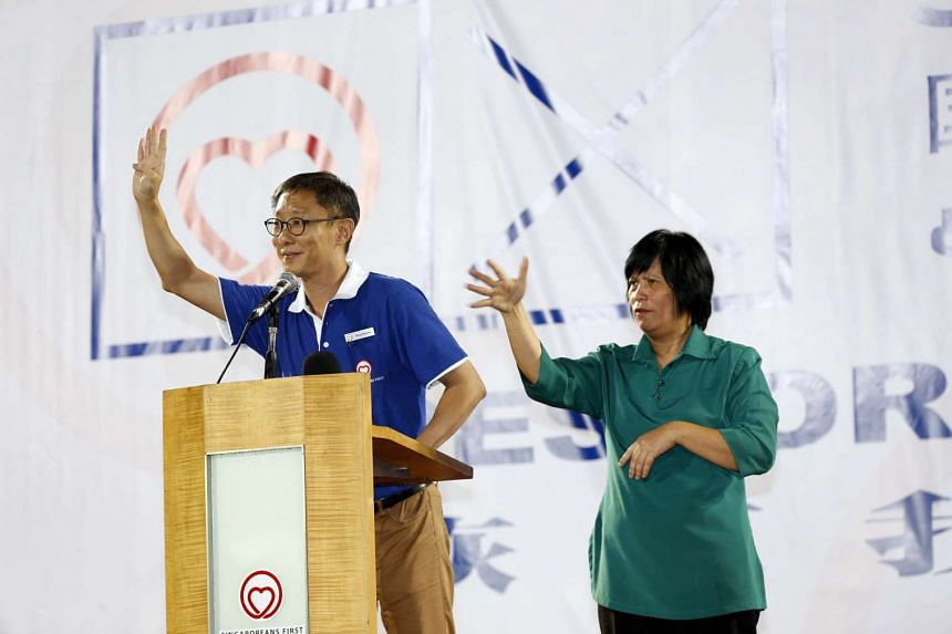 Mr Wong Chee Wai of the Singaporeans First party at its rally last Thursday, with an interpreter for those who cannot hear.