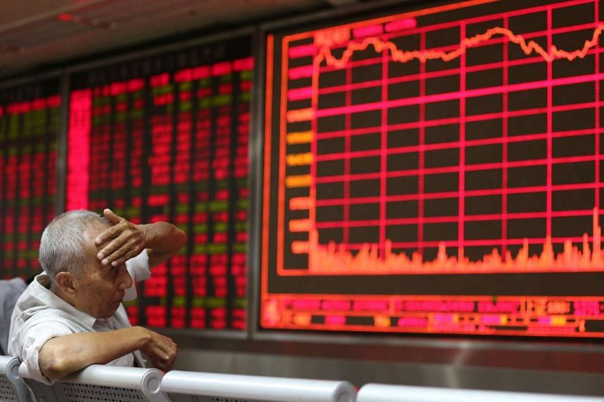 A worried investor in Beijing sitting in front of an electronic screen showing stock-market movements. Analysts are saying that China, while slowing, will avoid a hard landing as it has its property and service sectors to cushion the impact of fallin