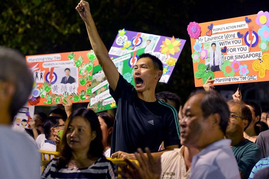 The crowd at the PAP rally for Chua Chu Kang GRC, with some showing support for Mr Lawrence Wong, the PAP's anchor minister for the Marsiling-Yew Tee GRC team.