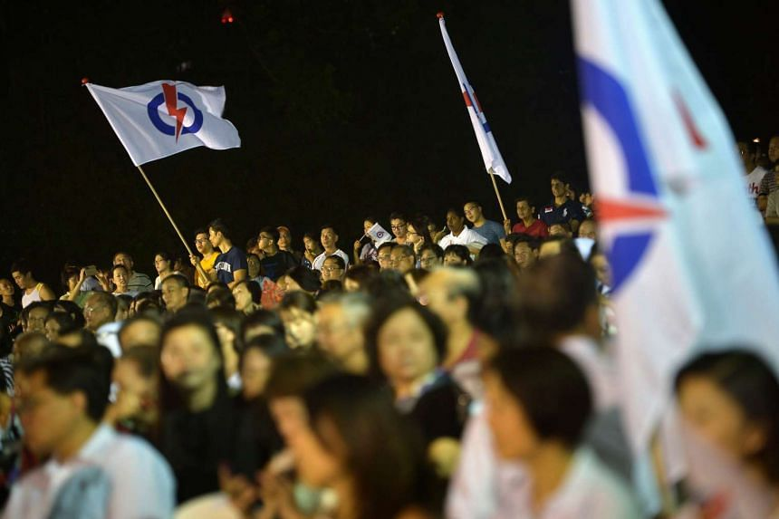 PAP supporters and spectators at the rally for Bukit Panjang SMC in Petir Road last night.
