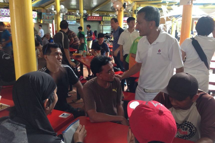 Dr Vivian Balakrishnan, who is contesting in the PAP team for Holland Bukit Timah GRC, interacting with residents at the Adam Road food centre.