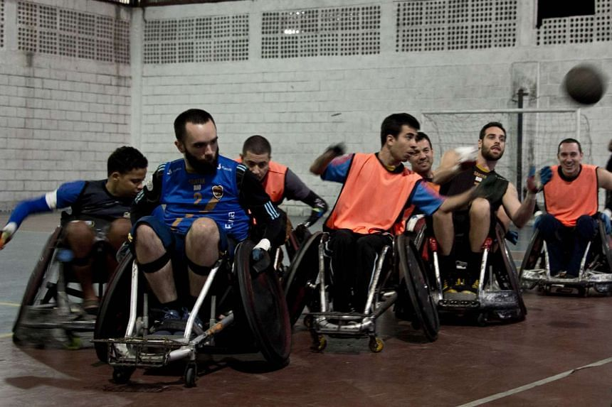 Paralympic rugby players, who are members of the Brazilian team, take part in a training session in Rio de Janeiro on Sept 2, 2015.