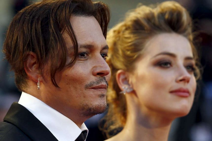 Actress Amber Heard (right) and husband Johnny Depp attending the red carpet event for the movie The Danish Girl at the 72nd Venice Film Festival, northern Italy on Sept 5, 2015.