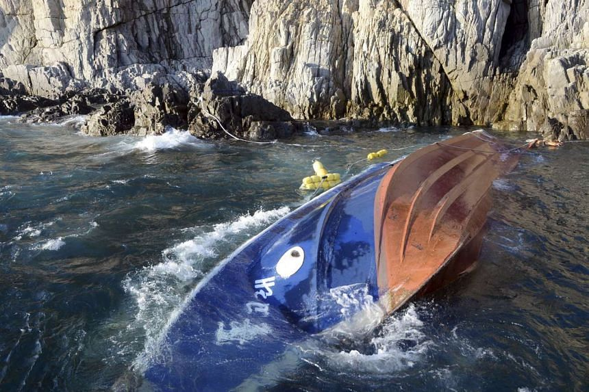 A capsized boat called Dolgorae, or Dolphin is seen at the sea off the southern island of Jeju, South Korea on Sept 6, 2015.