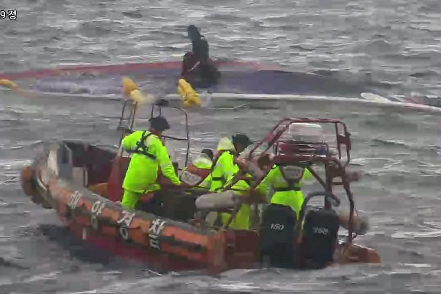 A handout picture released by Ministry of Public Safety and Security (NEWSIS) shows members of South Korean rescue team are searching to rescue after fishing boat Dolphin capsized near Chuja island on Sept 6, 2015.