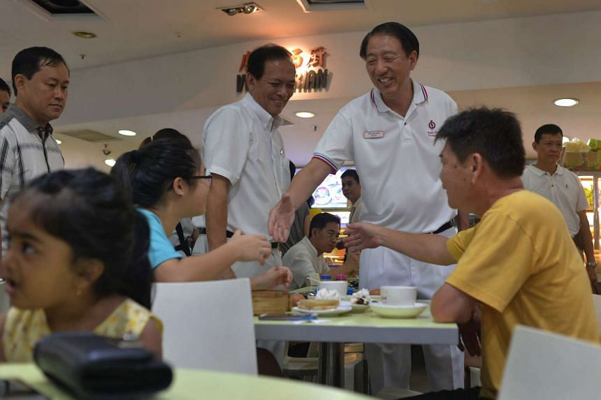 DPM Teo Chee Hean (right) and Charles Chong, candidate for Punggol East, meeting residents while on a walkabout at Rivervale Plaza on Sept 6, 2015.