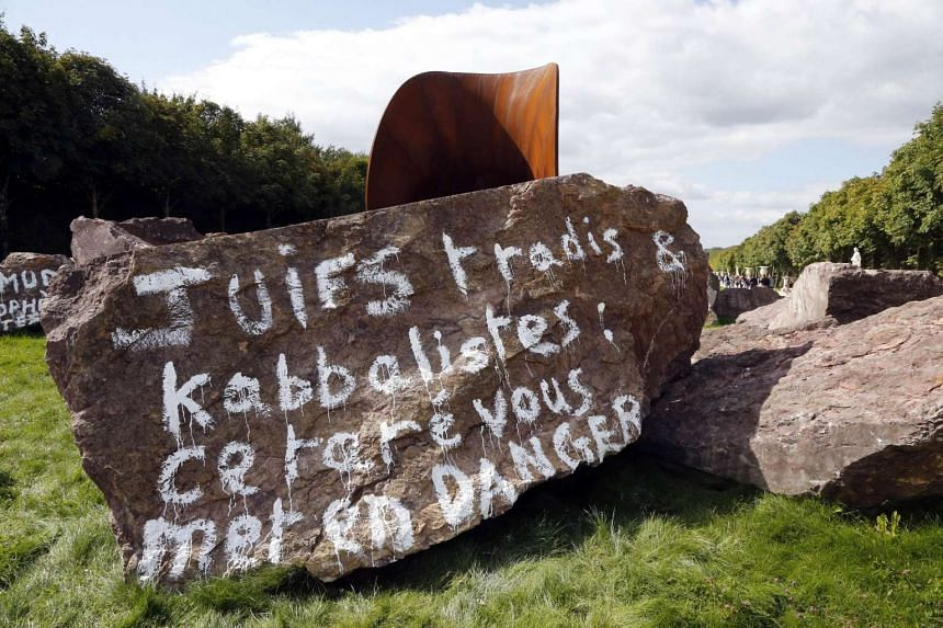 "The words on the stone read ""Traditional Jews and Kabbalists: this freak puts you at risk."""