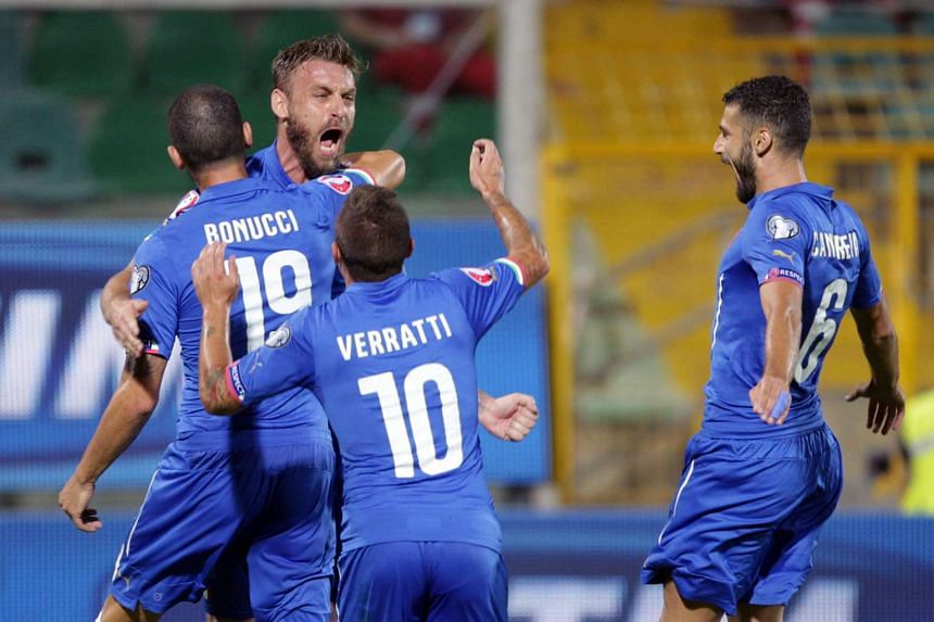 Italy's Daniele De Rossi (left) is congratulated by teammates after scoring during the Euro 2016 qualifying football match between Italy and Bulgaria on Sept 6, 2015.