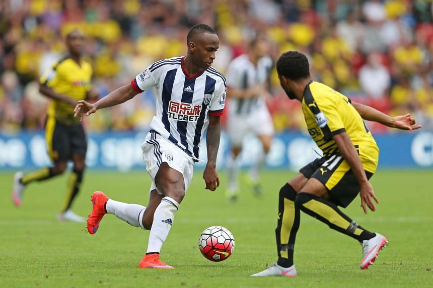 West Bromwich Albion's Saido Berahino (left) dribbles the ball against Watford's Ikechi Anya during their Premier League match at Vicarage Road on Aug 15, 2015.
