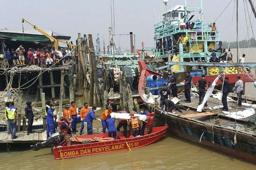 The bodies of 11 more Indonesian migrants including a young girl have been found, taking the toll from last week's boat tragedy to 61.