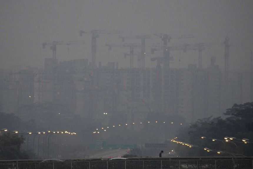 A HDB construction site shrouded by haze on Sept 7, 2015.