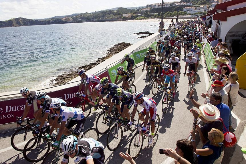 Riders compete at the start of the 175.8km 15th stage of the Vuelta Tour of Spain cycling race from Comillas to Sotres-Cabrales, northern Spain, on Sept 6, 2015.