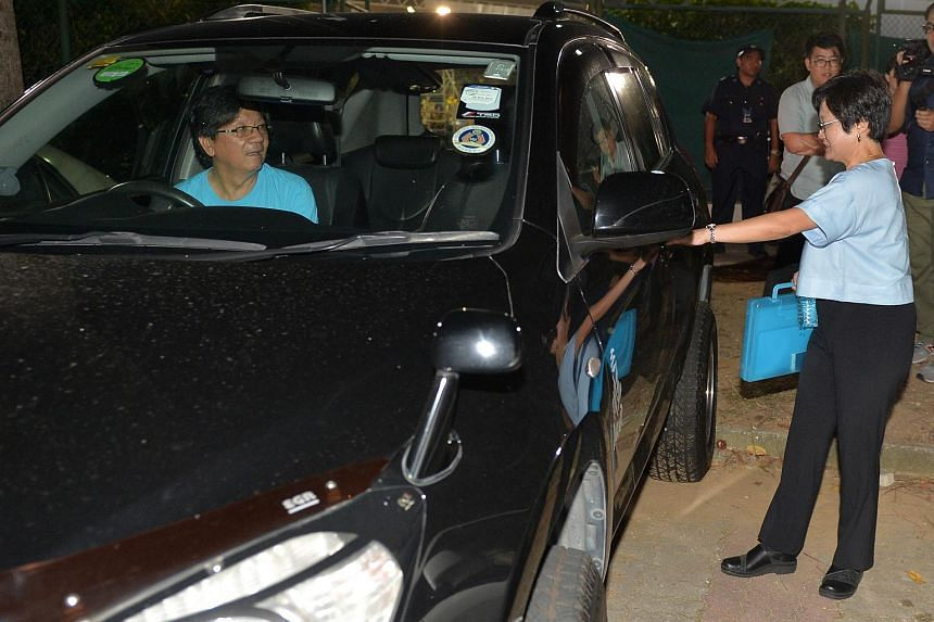 Workers' Party chairman Sylvia Lim getting into her boyfreind Quah Kim Song's car after the WP rally at Yishun Stadium on Sept 5, 2015.