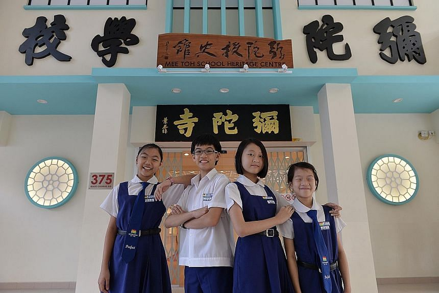 """To help visitors fully enjoy the new gallery (above), the school has appointed 10 """"heritage centre ambassadors"""" - including (from left) pupils Shiow Yu Xuan, Kiefer Ong, Chen Bailin and Brina Goh, all aged 11 - to take them on guided tours through its col"""