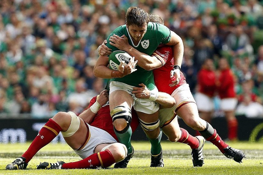 Ireland's Iain Henderson, here charging against Wales, has blended his imposing physique with athleticism to devastating effect.