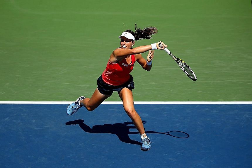 Johanna Konta of Britain hits a forehand against 18th seed Andrea Petkovic of Germany during her upset 7-6, 6-3 victory in the third round of the US Open on Saturday.