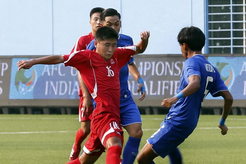 North Korea Under-15 midfielder Kwon Nam Hyok (in red) getting the better of his Thai opponents in a 2-0 win. The North Korean players are known for their tall and powerful frames despite their young age.