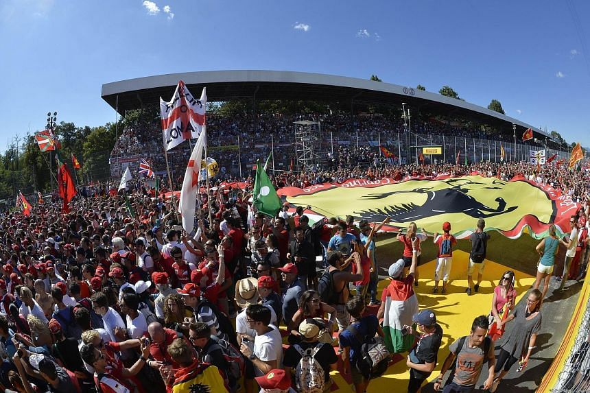 Sebastian Vettel and Felipe Massa praised the atmosphere as fans brandished a Ferrari banner after yesterday's Italian GP.