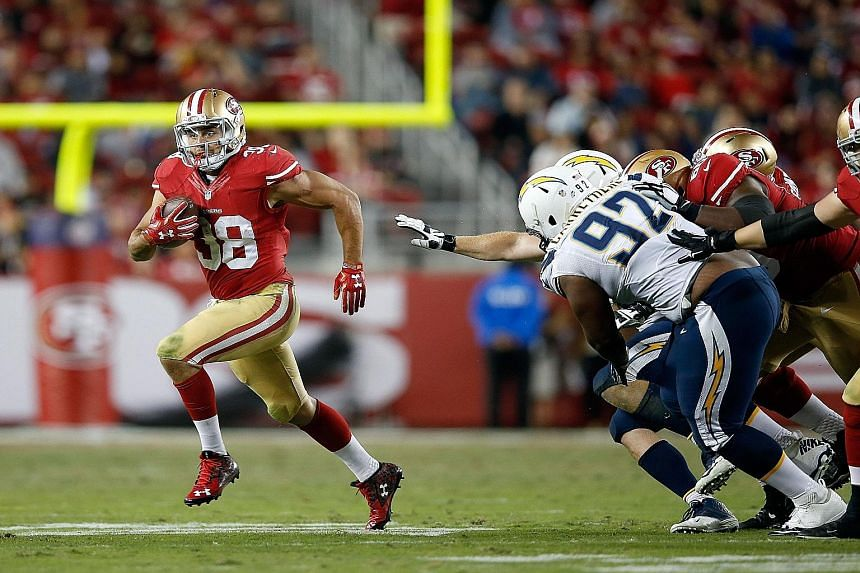 Jarryd Hayne (left) of the San Francisco 49ers outpacing his San Diego Chargers opponents during their NFL pre-season game at Levi's Stadium in California last Thursday. The Australian made the cut for the 49ers' final 53-man roster.