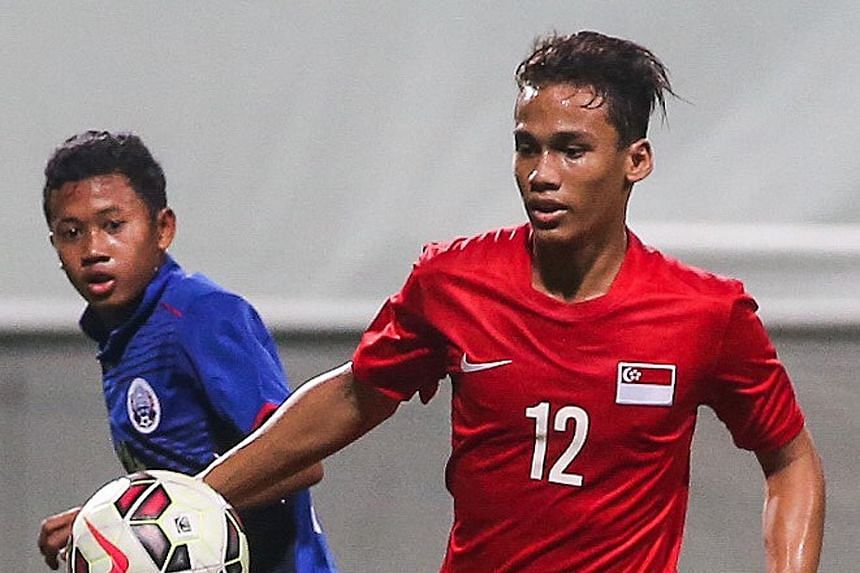 Irfan Jeferee (No. 12) scored Singapore's third goal in the 87th minute to seal the 3-1 win after Cambodia scored the opening goal.