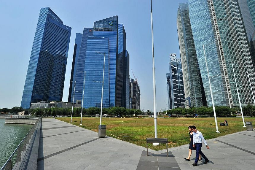 The financial and property sectors here are facing a slowdown and the resulting toll on corporate mergers and acquisitions and real estate conveyancing is causing a growing number of Singapore law firms to cut back on hiring.
