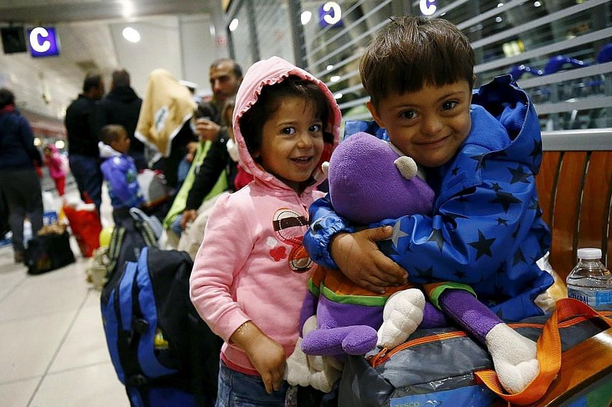 Two Syrian children sharing a stuffed toy given to them by wellwishers after they arrived by train from Budapest, Hungary, at Frankfurt airport's railway station in Germany early yesterday morning.