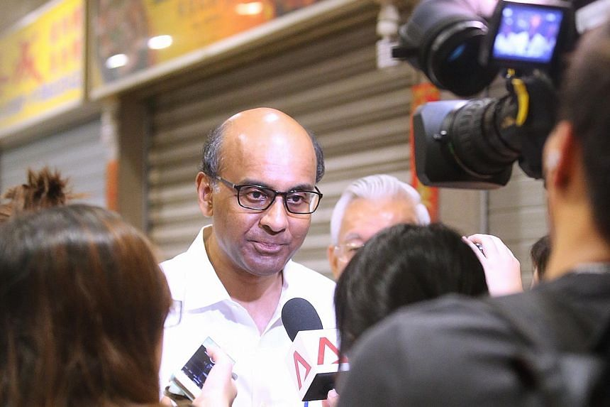 Singapore's success in an increasingly volatile and fragile world underlines the confidence of investors and businesses in the country, says Mr Tharman, who was at Taman Jurong Market yesterday.