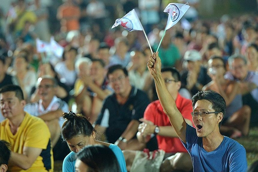 They went, they waved, they wore their stripes. Clockwise from above: Reform Party supporters with its flag at its rally for Radin Mas SMC; a Singapore People's Party supporter at its rally for Mountbatten SMC; and a Singapore Democratic Party suppor