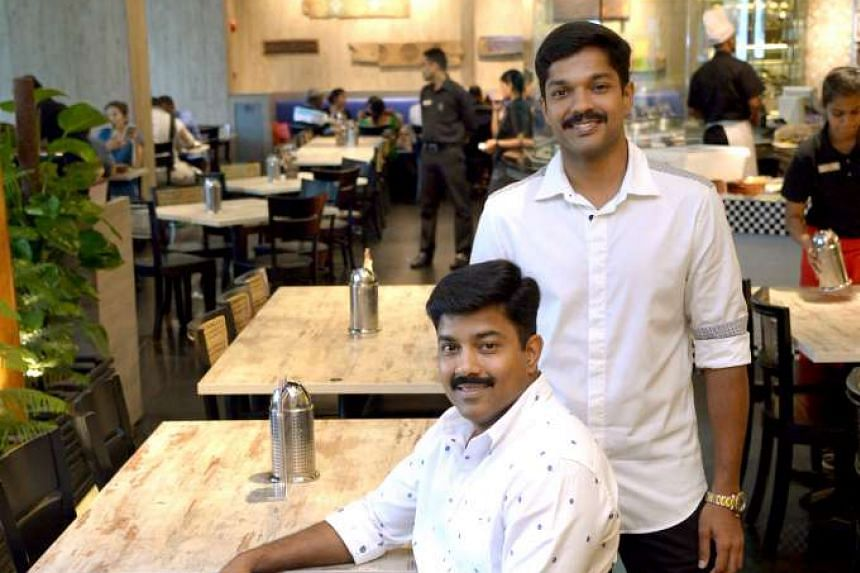 Mr Kasivishvanaath (left) and his younger brother, Mr Srinivasan, work closely, like finger and nail, at their family business, Muthu's Curry.