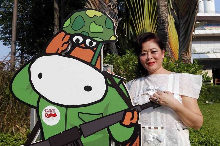 Mrs Jayne Kwek with one of her cut-outs, a soldier cow. There have been nine campaigns and more than 4,000 cows since they made their first appearance in 2005 in a teaser campaign by Moove Media, which she heads.The cows take shape from doodles she m