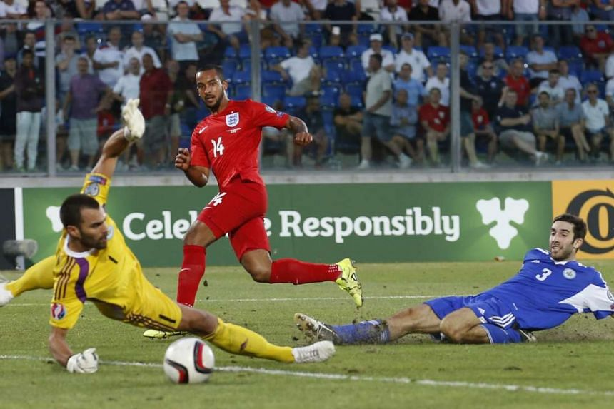 """Theo Walcott scoring in England's 6-0 victory against San Marino in the Euro 2016 qualifier on Saturday. Wayne Rooney said the lack of a Euro title, World Cup and FA Cup are a """"gap on my CV""""."""