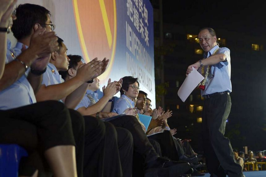 Workers' Party chief Low Thia Khiang returning to his seat on stage after delivering his speech at last night's rally in Simei Road. He was the only speaker yesterday who touched on the town council issue.