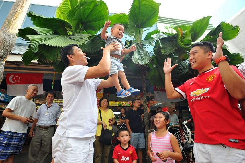 Mr Tan Chuan-Jin with 19-month-old Gyven Lim and his father Mr Vincent Lim on Sept 6, 2015.