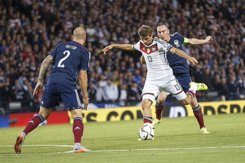 Germany's Thomas Mueller (centre) scores during the Euro 2016 group D qualifying match between Scotland and Germany on Sept 7, 2015.