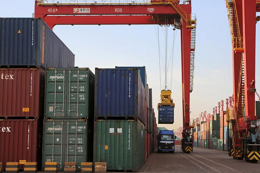 A container box is loaded on to a truck at a port in Rizhao, Shandong province.
