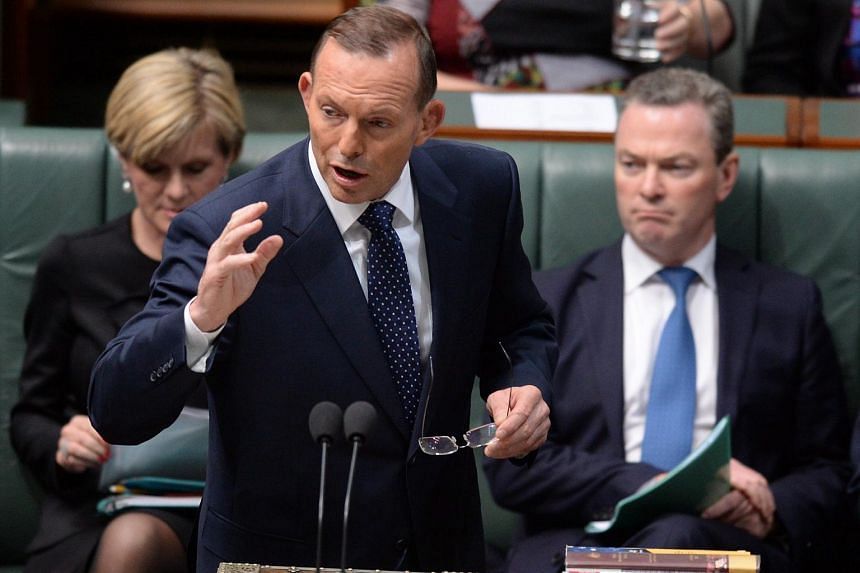 Australian Prime Minister Tony Abbott (centre) speaks about the Free Trade Agreement (FTA) with China during debate in the House of Representatives at Parliament House in Canberra, Australia on Sept 8, 2015.