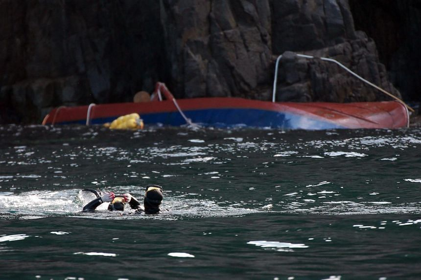 Rescue workers search for the missing off Chuja Island, north of South Korea's biggest island of Jeju on Sept 7, 2015.