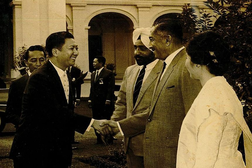 Mr Goh (left) shaking hands with the late President Yusof Ishak. Mr Goh Eng Wah in a 2007 file picture (left) and meeting Hong Kong actress Ivy Ling Po (above) at the airport.