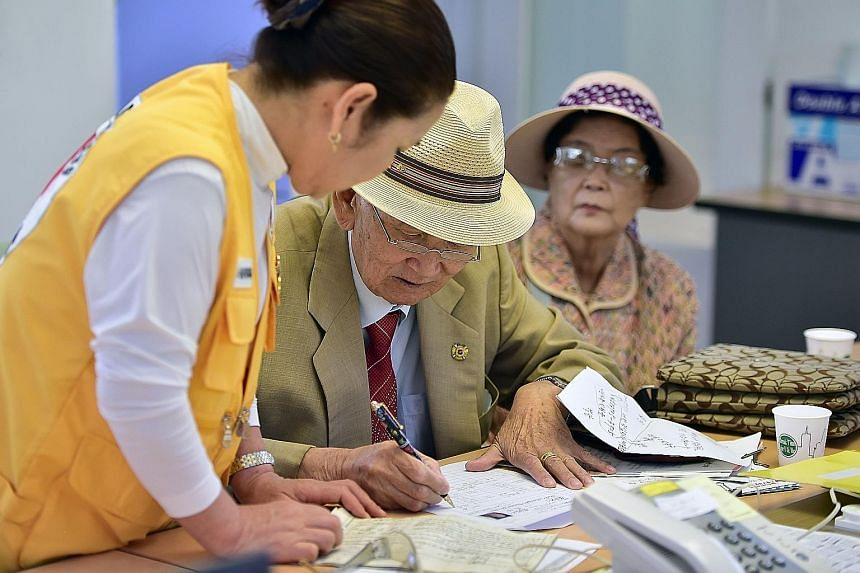 An elderly man at the Red Cross office in Seoul applying to be chosen for the next Korean family reunion.