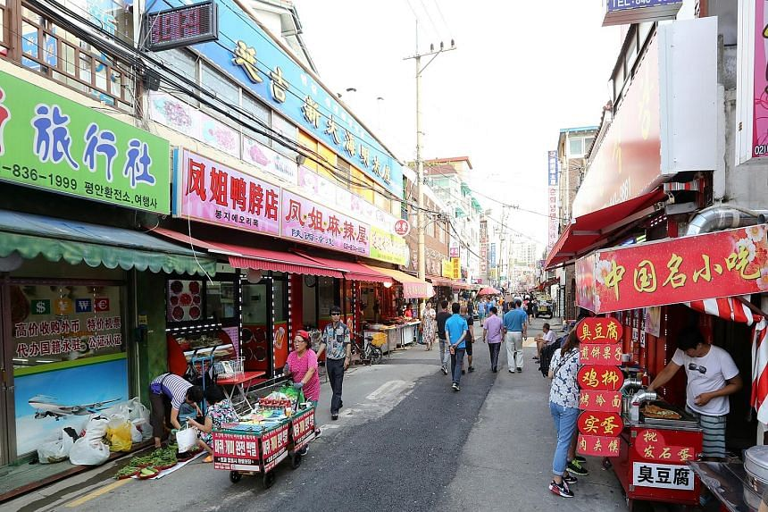 This street in Daerim-dong (above) is lined with Chinese restaurants offering all kinds of food, from spicy soup to street snacks like smelly toufu.