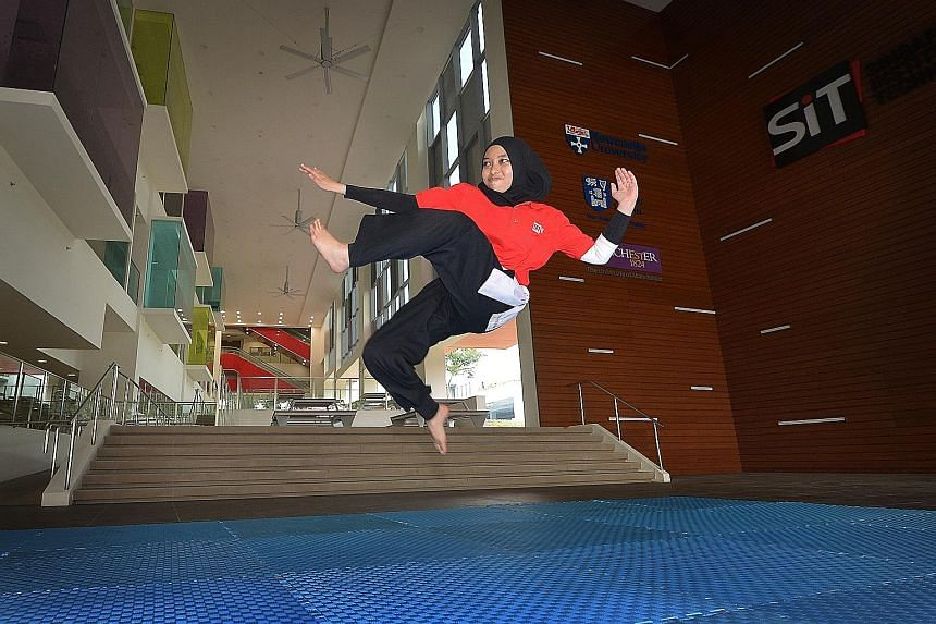 Ms Haziqah Haron executing a flying kick, more often seen when pesilats engage in choreographed fights. Practising silat helps strengthen core and leg muscles, which can aid in everyday tasks such as lifting items. As silat is a contact sport, care m