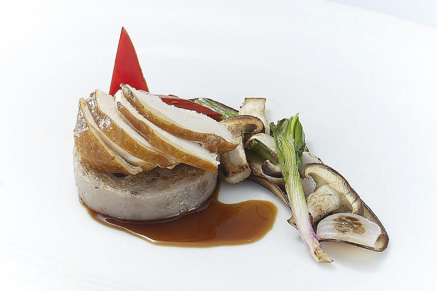 Soya chicken breast on pan-fried yam cake with grilled vegetables