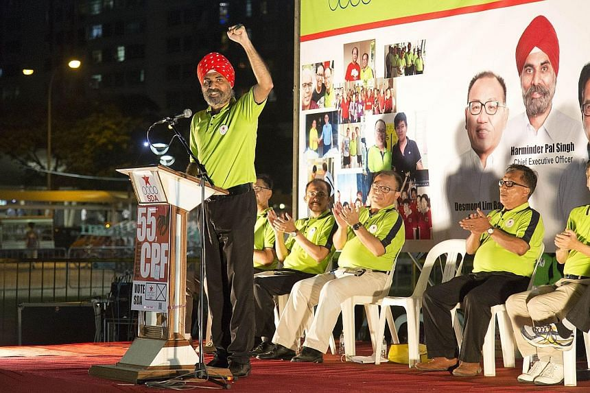 Mr Harminder Pal Singh of the Singapore Democratic Alliance gesturing to the crowd at his party's Pasir-Punggol GRC rally yesterday. People attending yesterday's People's Power Party rally in Chua Chu Kang GRC. The PPP is fielding four candidates - M