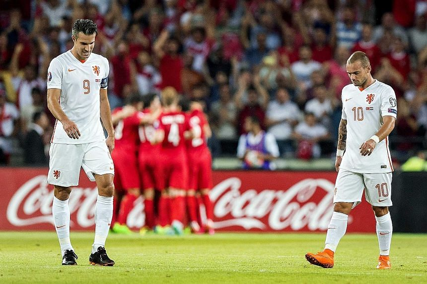 "The forlorn body language of the Netherlands captain Robin van Persie (far left) and Wesley Sneijder said it all after Turkey won their Euro 2016 Group A qualifier 3-0 in Konya, Turkey, on Sunday. ""I feel terrible, really terrible,"" said van Persie a"