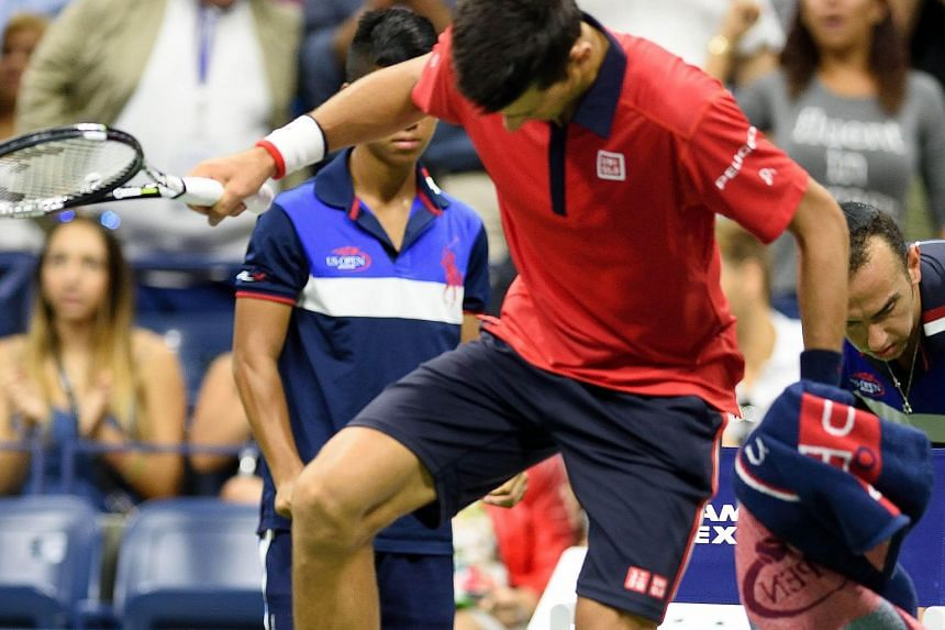 Novak Djokovic vents his frustration on his racket before he takes his game to another level to beat Roberto Bautista Agut to advance to the quarter-finals in the US Open. It is his 26th consecutive Grand Slam quarter-final appearance and Feliciano L