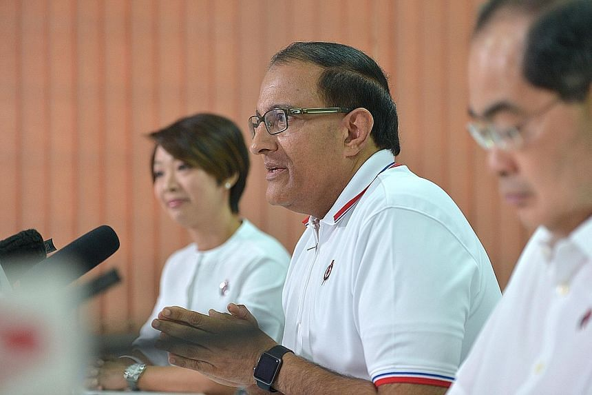 """PAP West Coast GRC candidates (from left) Foo Mee Har, S. Iswaran and Lim Hng Kiang say that the Reform Party's policy proposals on foreign workers and a minimum wage would put """"a fundamentally sound system"""" in jeopardy. Mr Iswaran said the RP's call"""