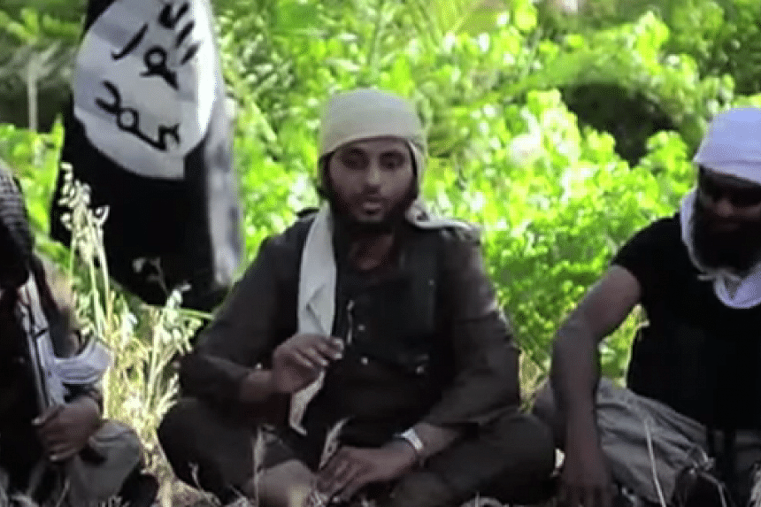 A recruiting video by ISIS featuring Ruhul Amin (right).