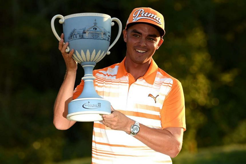 Rickie Fowler poses with the winner's trophy after winning the Deutsche Bank Championship at TPC Boston on Sept 7, 2015 in Norton, Massachusetts.