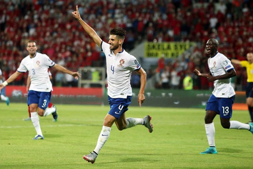 Portugal's Miguel Veloso (centre) celebrates after scoring during the Euro 2016 group I qualifying match between Albania on Sept 7, 2015.
