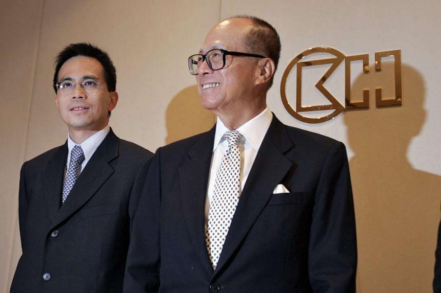 Hong Kong billionaire Li Ka-shing and his son Victor Li, chairman of Cheung Kong Infrastructure Holdings.